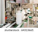 Mass production of plastic bottles - stock photo