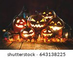 Small photo of Halloween pumpkin head jack lantern with burning candles