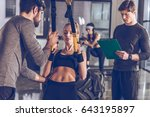 sportive woman exercising with... | Shutterstock . vector #643195897