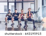 group of athletic young people... | Shutterstock . vector #643195915