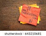 Small photo of HDL (good) and LDL(bad) cholesterol word abstract in vintage letterpress concept on a sticky note