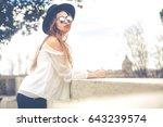 beautiful young woman outdoors...   Shutterstock . vector #643239574