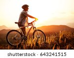 mountain cyclist at sunset | Shutterstock . vector #643241515