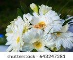wedding rings on a wedding... | Shutterstock . vector #643247281