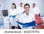 portrait of smiling dentist... | Shutterstock . vector #643274791