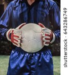 Small photo of Soccer Goalie Football player ready to defend its goal