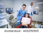 portrait of smiling dentists... | Shutterstock . vector #643290505