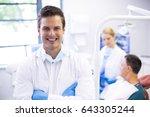 portrait of dentist standing... | Shutterstock . vector #643305244