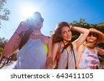 group of holiday girls enjoying ... | Shutterstock . vector #643411105