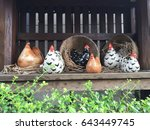 porcelain hens are displayed in ... | Shutterstock . vector #643449745