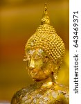 gold leaf on face  buddha... | Shutterstock . vector #643469371