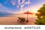 romantic beach sunset with deck ... | Shutterstock . vector #643472125