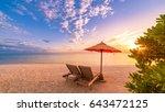romantic beach sunset with deck ... | Shutterstock . vector #643472125