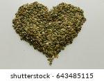 vegan food. raw pumpkin seeds... | Shutterstock . vector #643485115