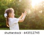 funny little girl catching soap ... | Shutterstock . vector #643512745