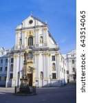 Small photo of Marian column and Church of Saint Vojtech / Adalbert, Lower square ( Dolni namesti ), Opava, Czech Republic / Czechia - historical sacral building made in baroque style (partly in shadow)