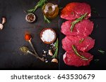 raw beef steaks with spices and ... | Shutterstock . vector #643530679