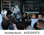 Small photo of Supporters of Presidential candidate Ebrahim Raeesi campaign for him in central Tehran on final day of campaigns before Iran's Presidential Election. Date: May 17th, 2007.
