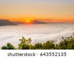 Sun Rise Over A Fog And Mountain