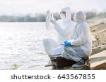 scientists or biologists... | Shutterstock . vector #643567855