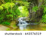 waterfall in the mountains | Shutterstock . vector #643576519