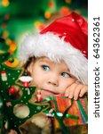 Happy Small Girl In Santa Hat...