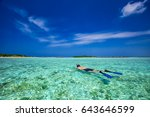 young man snorkling in tropical ... | Shutterstock . vector #643646599