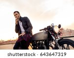 handsome rider man with beard... | Shutterstock . vector #643647319