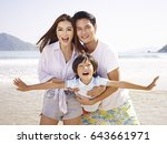 young asian couple carrying... | Shutterstock . vector #643661971