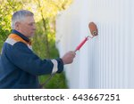 a gray haired construction man... | Shutterstock . vector #643667251