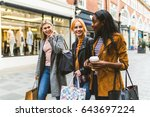 Girls Shopping And Walking In...