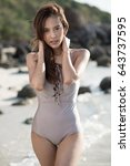 sexy asian woman in bikini one... | Shutterstock . vector #643737595