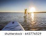 standup paddler at the lake...   Shutterstock . vector #643776529