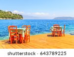 tables and chairs next to the... | Shutterstock . vector #643789225