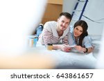 couple choosing paint colour... | Shutterstock . vector #643861657