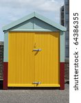 Beach Hut With Yellow Doors On...