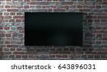 big flat screen tv hanging on... | Shutterstock . vector #643896031