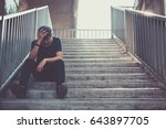 depressed man sitting head in... | Shutterstock . vector #643897705