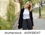 beautiful blonde woman in urban ... | Shutterstock . vector #643938247