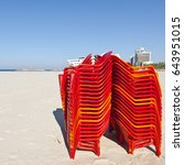 plastic chairs on the beach of... | Shutterstock . vector #643951015