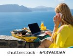woman working while on vacation ... | Shutterstock . vector #643960069