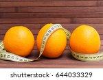 fresh fruits orange wrapped in... | Shutterstock . vector #644033329