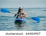 woman kayaking in a tropical sea | Shutterstock . vector #64404907