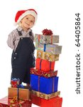 Smiling little boy with Christmas gift boxes - stock photo