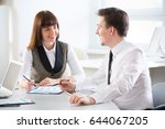 businesspeople in a meeting at... | Shutterstock . vector #644067205