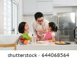asian family cooking at kitchen ... | Shutterstock . vector #644068564