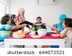 happy muslim family enjoying... | Shutterstock . vector #644072521