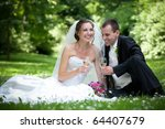 wedding couple in the park | Shutterstock . vector #64407679
