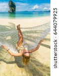 woman relaxing at the beach on... | Shutterstock . vector #644079925