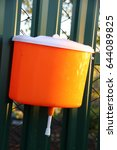 Small photo of Garden hand washer affixed to a fence